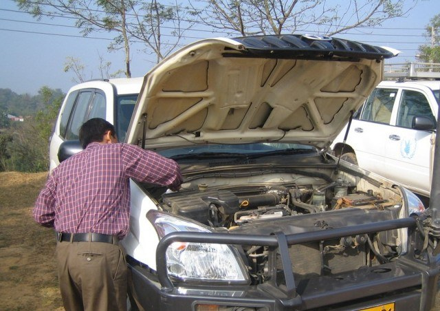 driver inspecting toyota landcruiser